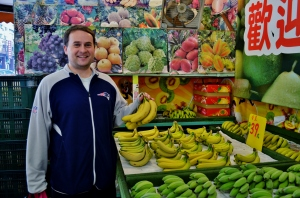 Here's Aaron at the local fruit market round the corner from our house. He buys bananas there every day. Everything is out in the open, so it's wonderfully easy to use our own bags! In fact, Aaron just sticks the whole bunch in his backpack.