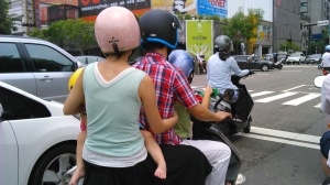 This family on a scooter is very typical for Taiwan. I commend them for at least putting helmets on their kids. A lot of parents don't. I've seen parents holding babies in Ergos on the back of the scooter, and sometimes just in their arms. No helmets. Babies. They also don't generally use car seats here, though we will, when we need to take a taxi. We aren't buying a car. But no way is Anna going on a scooter! At least not for a looooong tiiimmmme....
