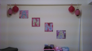 Here is her Wall! Signs are made from scrapbook paper, cardboard, and Modge Podge.